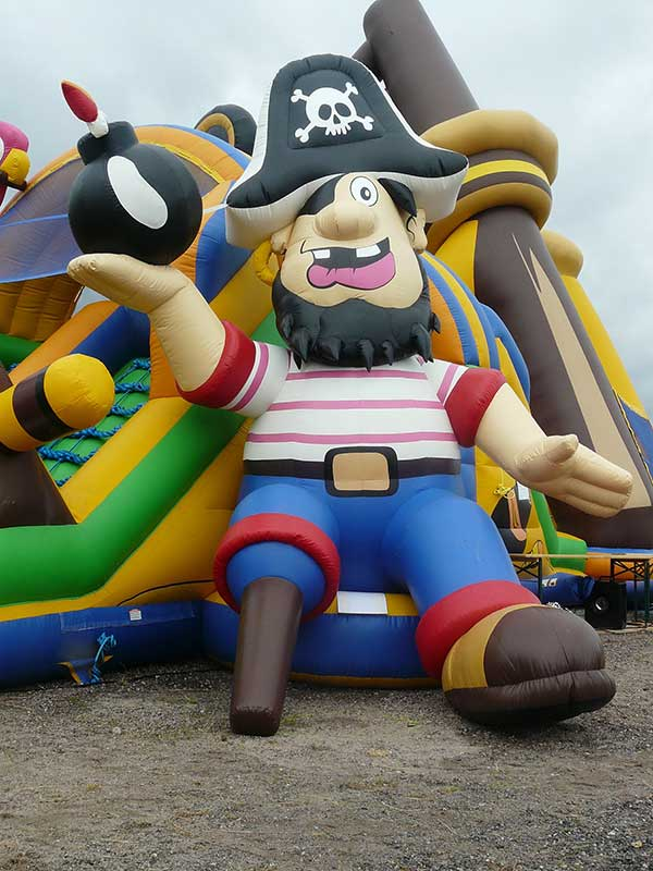 Bouncy castle insurance - Pirate themed Inflatable showing a one-legged pirate