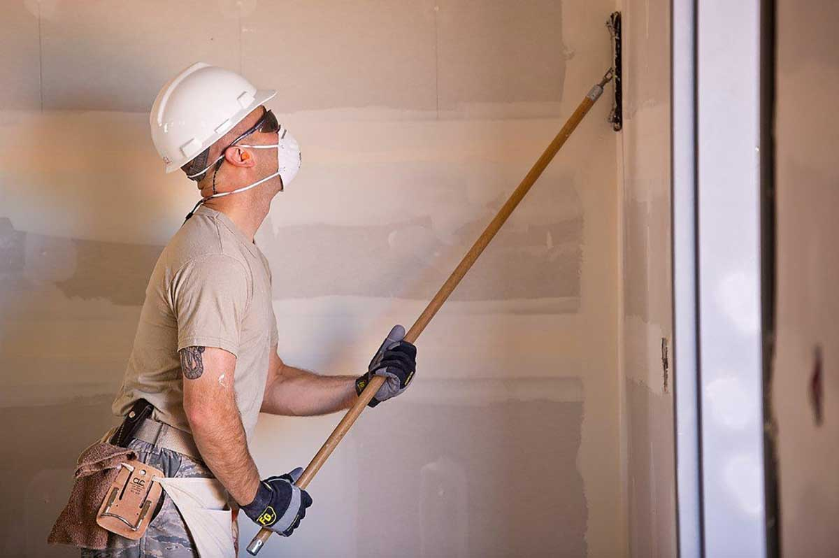 Painter prepares to start work safe in the knowledge he has the correct insurance